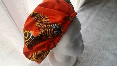 Satin lined Ankara ladies bonnets in orange /black colour.satin  hats.silk lined