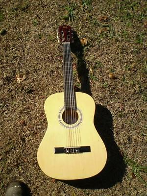 Tribute accoustic guitar  steel & nylon strings in good used condition 92cm long