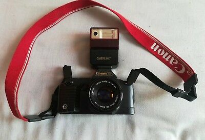 Canon T70 camera with lens and flash lamp