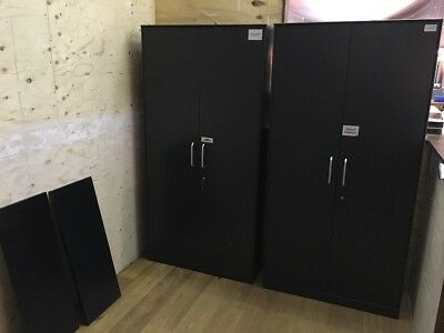 Two used metal filing cabinets