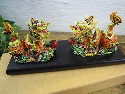 Two multi  coloured small Resin Chinese Dragon Ornament on base boxed