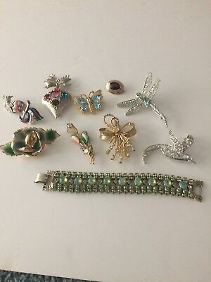 10 pc. lot of costume jewelry 9 pins and one green opalescent bracelet.