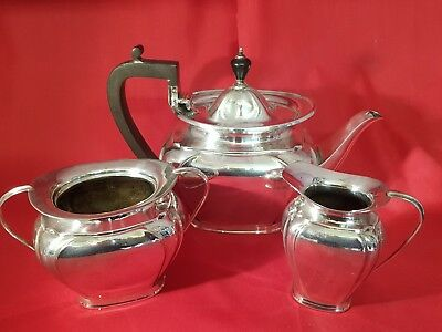 an antique silver plated tea set by roberts & belk.sheffield.very collectable.