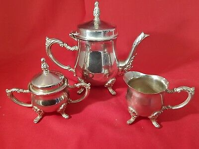 a very elegant vintage silver plated bachelor tea set with decorated patterns.