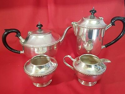 a very elegant vintage 4 piece silver plated tea set.made in england.ornate.