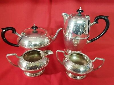 a beautiful antique hand engraved 4 piece silver plated tea set.very ornate.