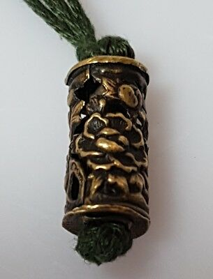 A lovely Meiji period Metal Ojime pierced & Decorated with flowers & a lion dog