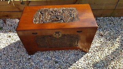 A Camphorwood Chinese Chest with Hand Carved Landscapes heavy beautiful piece