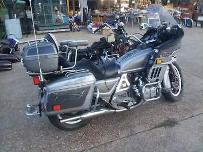 1982 Honda Gold Wing  82 silver runs rides stops etc with title and 83 burgundy no title no seat