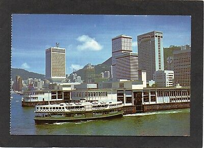 HONG KONG - New building next to Star Ferry Pier. Boat.  S.C.Moy photo postcard.