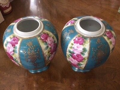 Two Chinese roses and gold gilt vases