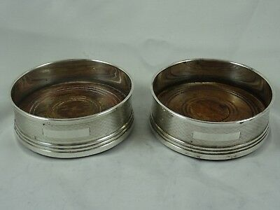 PAIR solid silver BOTTLE COASTERS, 1982