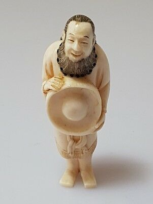 A 19th century Meiji period Netsuke of a Dutch man. Signed Hidekazu.