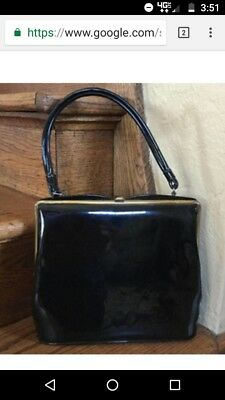Vintage: Black vinyl with Gold trim and clasps. Theodor California purse/handbag