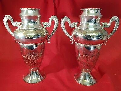 a pair of beautiful antique silver plated vases with dragon decorations.rare.