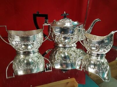 a beautiful vintage silver plated embossed tea set made in sheffield.chased.