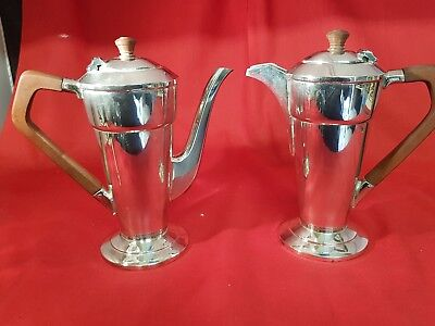 2 antique silver plated tea pots by walker and hall.sheffield.very collectable.