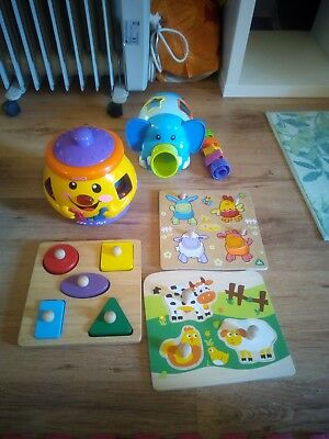 various shape sorters and peg puzzles