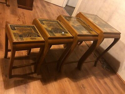 Nest Of Oriental Carved Tables Four occasional tables exaggerated legs and carve