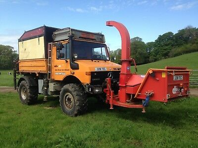 Unimog U1650 with Front mount chipper, Hiab 071 crane and trailer.