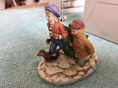 "Norman Rockwell Museum  Figurine   ""Bringing Home The Christmas Tree"""