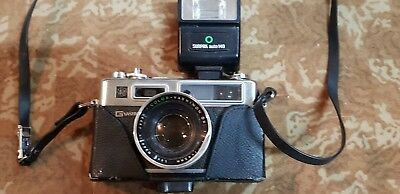VINTAGE COLLECTABLE YASHICA CAMERA SUNPAK AUTO 140 made in JAPAN