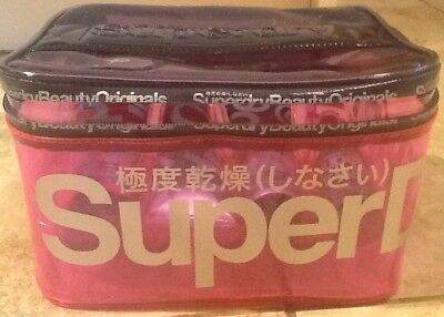 Super Dry + Life Style Edit Zipped Bag  Contains Super Dry Products For Ladies