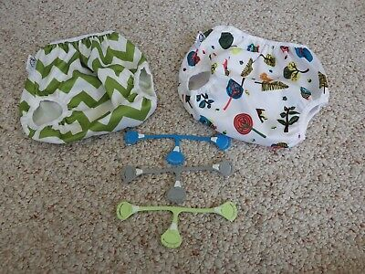 3 Snappi Diaper Fasteners and 2 small Nicki's diaper covers