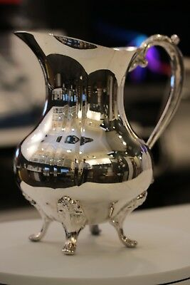 "Sheridan Silver water  carafe with four legs.  9"" tall x 5"" wide"