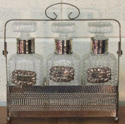 Antique plated tantalus with 3 cut glass decanters for sherry,whisky,gin