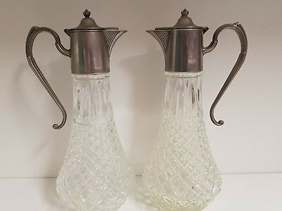a pair of antique silver plated/cut glass claret jugs with very elegant patterns