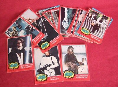 34 Star Wars trading cards. 3 blue set and 31 red set. ?1977.  Good condition.