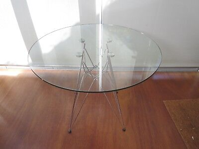 clear tempered glass top table, 'eiffel tower' style legs, 900mm diameter