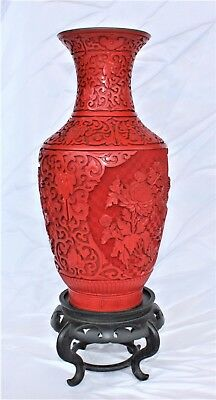 A large deeply decorated cinnabar vase.