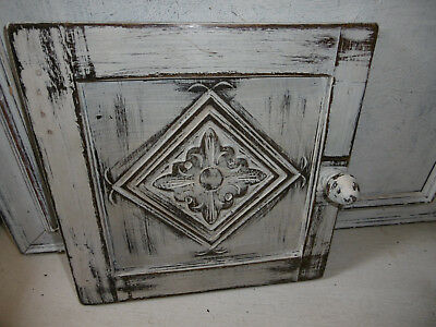 Vintage antique carved wooden cupboard door with distressed paint finish