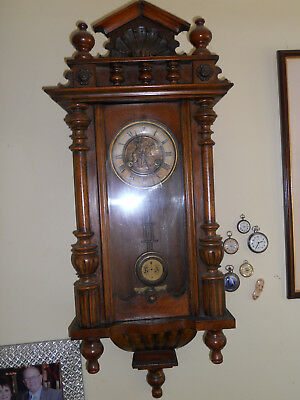 Antique German Wall  Clock.WRGM.With Dutch  Folklore Brass clock face.Oak case.