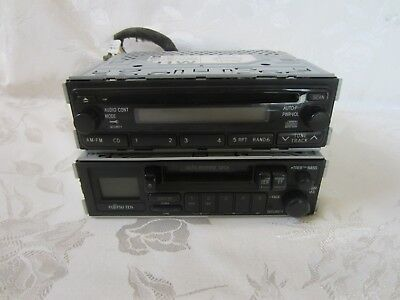 2 Fujitsu Ten Car Radios, 1 With Cassette Player Other With CD Player