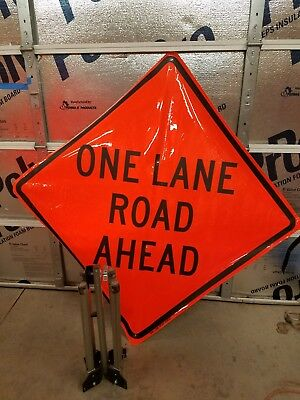 One lane road ahead road sign and stand