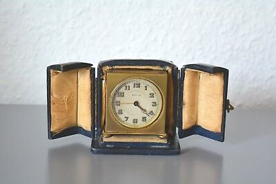 Zenith - Art Deco travel/alarm clock. Swiss Made. Brass Gilt. Cased.