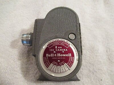 Vintage Bell & Howell 134, 8mm Movie Camera with old roll of film inside