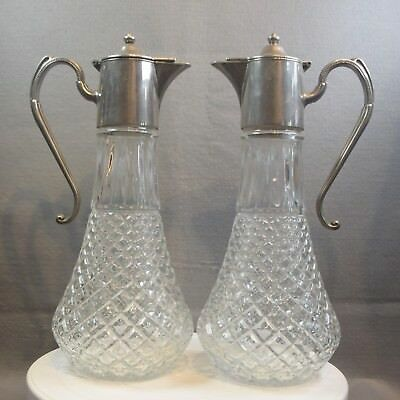 A Pair Of Cut Glass And Silver Plate Claret Jugs