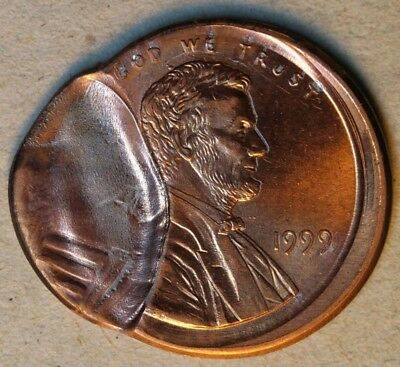 Broadstruck 1999 cent with partial brockage from off-center cent