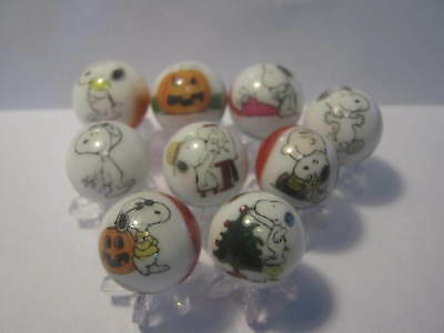 snoopy from the peanuts gang 5/8 size glass marbles with stands