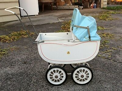 Retro 50s Cyclops metal dolls pram with vinyl hood and rubber wheels