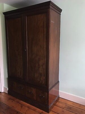 large antique looking wooden wardrobe