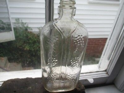 Vintage One Pint Clear Glass Grape Embossed Wine Bottle