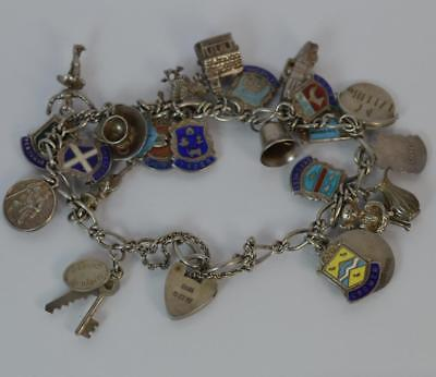 Solid Silver Ladies Charm Bracelet with 24 Charms