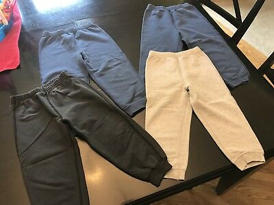 Hanna Andersson - four pairs of sweatpants - gray, black, navy blue - size 100