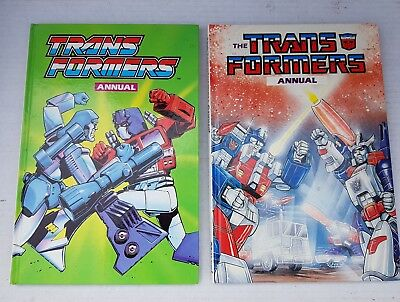 VINTAGE 1987 + 1989 the TRANSFORMERS ANNUAL HARD BACK very clean
