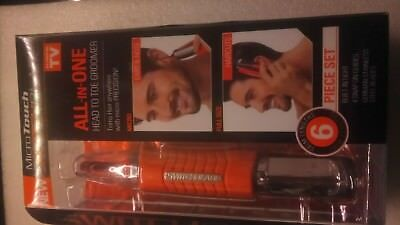 Microtouch switchblade  all in one head to toe precision AAA battery groomer